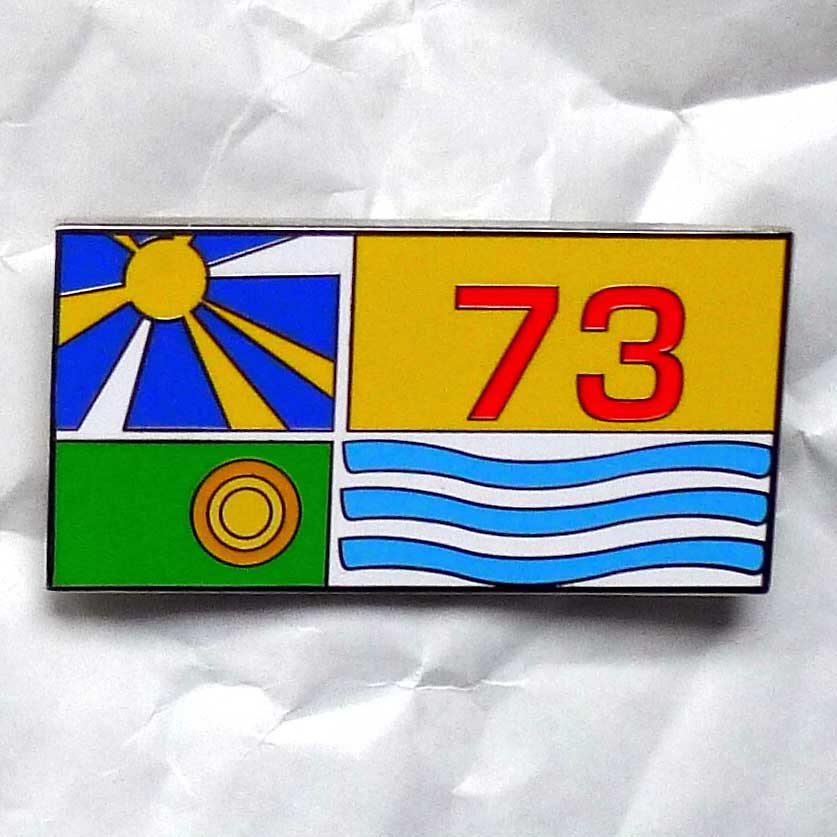 Enamelled flag badge